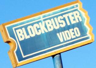 """Distressed Blockbuster Video Sign"" by trebomb on Flickr."